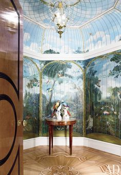 A trompe l'oeil birdcage mural by Frederik Monpoint decorates a London home