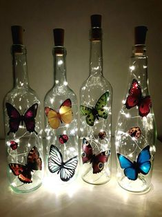 lightbottle bottle with light chain zen-like picture light Recycled Glass Bottles, Glass Bottle Crafts, Wine Bottle Art, Painted Wine Bottles, Lighted Wine Bottles, Diy Bottle, Painted Wine Glasses, Bottle Lights, Bottle Jewelry