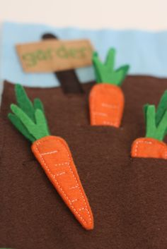 Quiet Book - I don't know why I love these felt carrots so much but they are adorable!