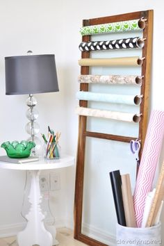 Gift wrap storage from an old door! So creative!