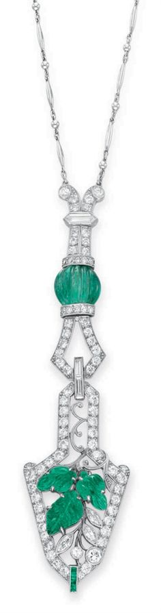 AN ART DECO DIAMOND AND EMERALD PENDANT NECKLACE  -  Suspending an openwork circular-cut diamond arrow-shaped pendant, centering upon three carved emerald leaves with scrolling platinum stems, decorated with marquise and baguette-cut diamond detail, from a circular, single and hexagonal-cut diamond geometric link, centering upon a carved emerald bead, to the fine link platinum neckchain, mounted in platinum, circa 1925.