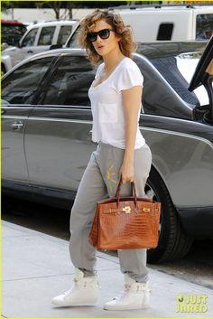 Jennifer Lopez wearing Hermes Shiny Crocodile Birkin Bag in Miel, Buscemi Alta Leather Wedge Sneakers and Tom Ford Celina Sunglasses