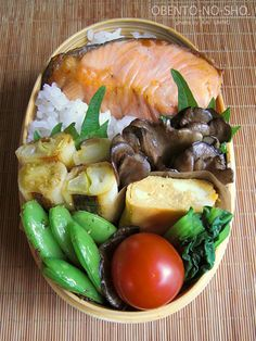 Traditional grilled salmon on rice Japanese Bento Box Lunch. / Food to go with the LitWits experience of THE BIG WAVE by Pearl S. Buck / For unique, hands-on activity ideas, literature teaching tips, and LitWits Kits for great books, visit http://www.litwitsworkshops.com/free-resources/