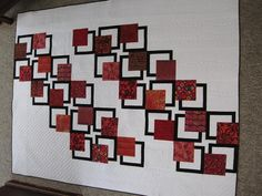 Modern Reds I've Been Framed Quilt by Donna James in British Columbia.