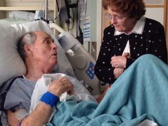 In touching video, man sings to wife of 66 years from hospital bed