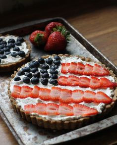 This Berry Tart is made with a rich Brown Butter Shortbread Crust, and has the berries in the shape of an American flag to celebrate the Fourth of July!