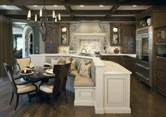 Curved kitchen island, round table, banquet seating