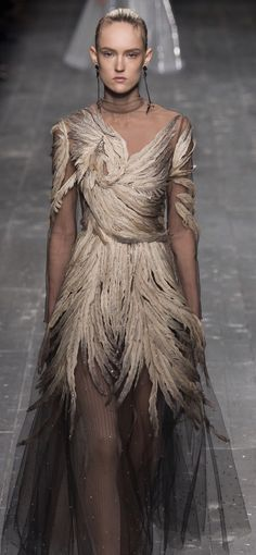 This is actually kind of pretty, but I can't get over that it looks like a bird crashed into her, like she was a skyscraper window - Valentino fall 2016