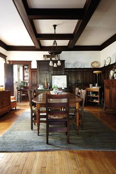 Love the coffered ceilings. But all the wood in the house makes the room seem dark. I would add lighter pieces