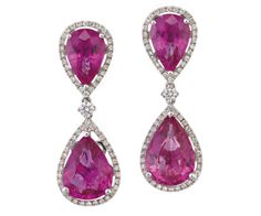 PAIR OF PINK TOURMALINE AND DIAMOND PENDANT EARRINGS Each cluster surmount claw-set to the centre with a pear-shaped tourmaline within a round brilliant-cut diamond surround suspending a similarly set tourmaline and diamond cluster.  18ct white gold.