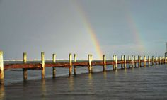 Rainbow over the pier at Navarre Beach, courtesy of Navarre Properties, www.beachguide.com/Navarre/BeachHouses Navarre Beach, Sandy Beaches, New York Skyline, Beach House, How To Memorize Things, Coast, Florida, Cottage, Vacation