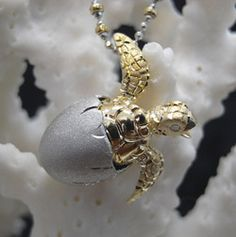 Hatching Turtle bead pendant necklace yellow and white  gold.