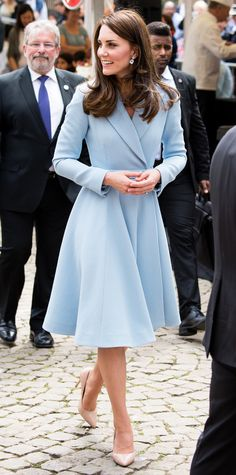 Kate Middleton was a real life Cinderella in this powder blue A-line coat which she paired with classic nude pumps and stunning diamond jewelry.