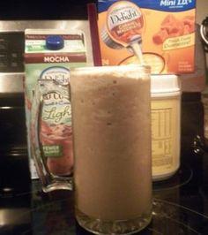 CREAMY CARAMEL MOCHA Protein drink:1 cup Lt mocha iced coffee, 1 serving vanilla protein shake powder, 1 caramel macchiato mini IDs creamer, 1/2 cup water, 1 cup ice. Blender