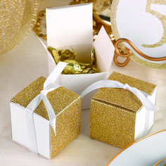 Wedding favors with glitz are wonderful for so many reasons. Take our Gold Glitter Wrap Favor Boxes, for instance. A simple white…