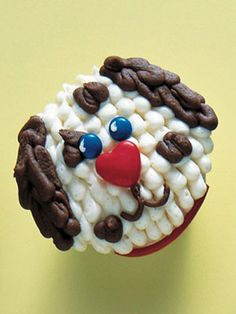 Spotted Puppy  Use white frosting to pipe 1/4-inch beads to cover the top of a cupcake. Use chocolate frosting to pipe ears, spots, and mouth. Attach a small red candy heart for the nose and mini M's for eyes. Attach a 2-inch piece of red shoestring licorice for the collar.
