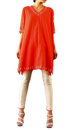 Be fashionably relaxed in your own skin. A flowing kite silhouette that marries red and nude - never the norm, Abraham & Thakore do it with the highest of quality and style.    http://strandofsilk.com/abraham-thakore/product/womenswear/salwars/red-silk-ultra-chic-salwar-suit [i like the coordinating trim at the bottom of the trousers. It finishes the look, one a western woman can wear with confidence. tcm]