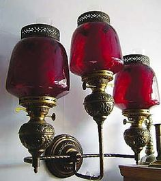 Antique lighting fixture with red glass shades from Pierce's 1894 Restaurant. Maybe deeply dyed, upside-down mason jars? Antique Chandelier, Antique Lamps, Antique Lighting, Vintage Lamps, Chandeliers, Antique Light Fixtures, Cranberry Glass, Home And Deco, Restaurant