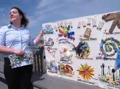 Erin O'Neill, a student volunteer with the Clean Ocean Action environmental group, holds a poster on... - AP Photo/Wayne Parry