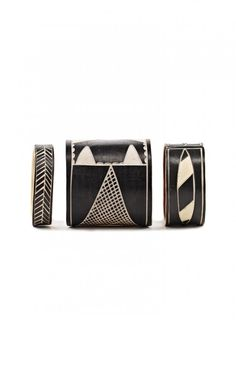 Cuffs handcrafted by Namibian artisans from plastic water pipes.