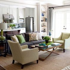 "brown couch; green and tan accents. (From ""Five ways to decorate with a brown sofa"")"