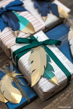 DIY Gold Tipped Paper Feather Topper takes your gift wrapping and packages to a new level. From MichaelsMakers Lia Griffith