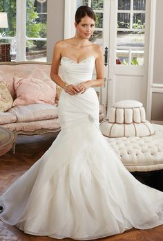 Sophia Tolli - A stunning skirt featuring skillfully crafted layers of fantasy organza is the standout feature of modified mermaid Cornflower. Crystal and pearl hand-beading trim the strapless sweetheart neckline while the asymmetrically draped bodice emphasizes the form-fitting silhouette. A corset back closure finished with a beaded motif, chapel length train and removable straps complete this glamorous gown.