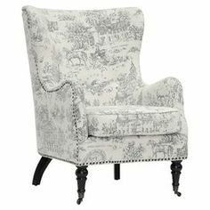 """A perfect addition to your living room or master suite, this charming wingback arm chair showcases a toile motif, nailhead trim, and turned front caster feet.    Product: ChairConstruction Material: Engineered wood, polyurethane foam and linenColor: Beige and periwinkle blueFeatures:  Nailhead trimTurned front caster feetDimensions: 41"""" H x 29.37"""" W x 35.25"""" DNote: Minor assembly requiredCleaning and Care: Spot clean only"""