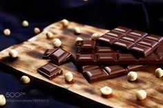 http://500px.com/photo/189758215 Chocolate food by ridvan_arda -Digital effect filter for color correction and toning. Tags: macrophotofoodboardfabricnutseffectsnackfilterdessertcolor imagepieceselective focushazelnutdigital manipulationstudio shotsChocolate