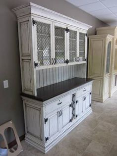 """antique white hutch, Painted, glazed, and distressed buffet cabinet. Dark stained walnut top, Iron hardware and detailing, Wine rack. 76"""" wide, 21"""" deep, 89"""" tall."""