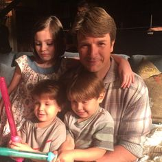 Nathan with the #Castle kids. THEY LOOK SO MUCH LIKE NATHAN AND STANA IM BROKEN I CANT! WHERE'S THE PIC WITH STANA?!