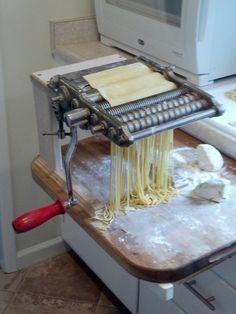 Vintage hand cranked pasta machine.