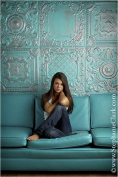 turquoise vinyl couch and background  Stephanie Clark Photography.  Cool wall tiles.