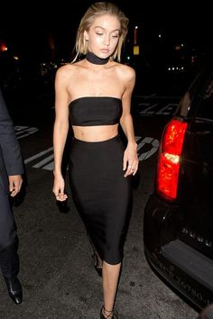 Gigi Hadid wearing House of CB Black Bandage Two Piece and Le Silla Ankle Boots