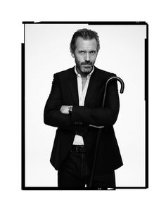 Love this picture. The tone of black and white and the expression on hugh's face