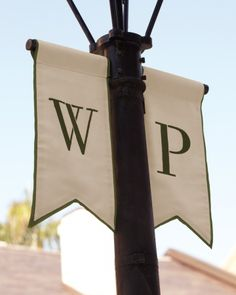 This couple's initials were made into banners and hung from lampposts in front of the venue