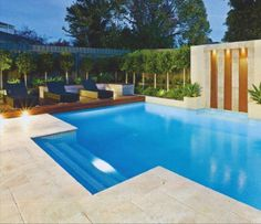 Pool with travertine pavers and decking