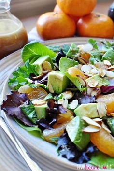 Mixed Greens Salad with Mandarins, Toasted Almonds, Avocado, and Sesame Ginger Vinaigrette by sonya