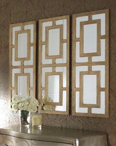 "Geometric Wall Mirror pebbles"" wall decor. a cluster of mirrored ""pebbles"" makes for"