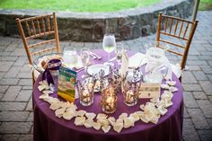 Rose petals and flickering lavendar-enhanced votives adorn the bridal table at Tushara and PJ's Tyler wedding - by Buttercup: Daniel Fugaciu Photography.