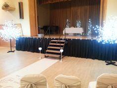 Wedding stage lit for ceremony.