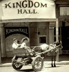 The photo dates from 1957 the horse and buggy from an earlier era. The Kingdom Hall Store was located in Burt St Boulder Australia