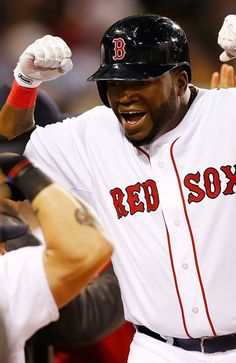 BOSTON, MA - MAY 23: David Ortiz #34 of the Boston Red Sox celebrates with his teammates near the dugout after hitting a three-run home run in the third inning against the Cleveland Indians during the game on May 23, 2013 at Fenway Park in Boston, Massachusetts. (Photo by Jared Wickerham/Getty Images)