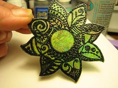 crayon and wax paper with embossing powder!