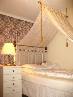 Idea how to make canopy with curtain rod and curtains
