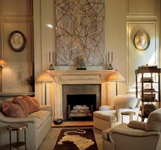 A classically designed living room by Bunny Williams.  Love how the abstract painting energizes the space.