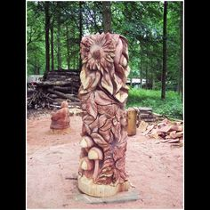 this piece of sunshine was carved out of a tree by use of a chain saw!!  the artist is Tommy Craggs