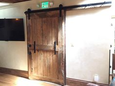 This is one of our favorite pieces yet! This beautifully hand crafted piece is an antique pine wood barn door with a live edge. It is the perfect