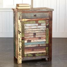 Useful in so many places, this taller-than-average cabinet adds a horizontally slatted door to reclaimed wood with its vintage paint finish. Planked top, one fixed shelf, one drawer. No two cabinets are alike in color placement. Imported.