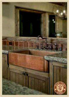 hammered copper sink.. Preferably in a white kitchen..